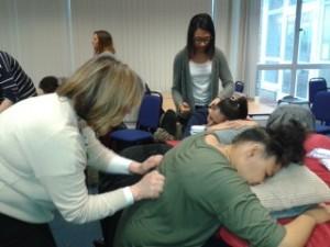 Teachers learning Peer Massage from Carole