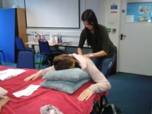 Teachers learning Peer Massage from Carole